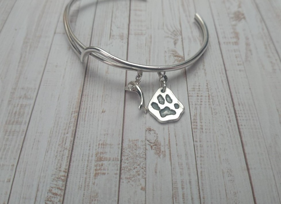 Dying matters - silver paw print charm on silver bangle is a precious memory