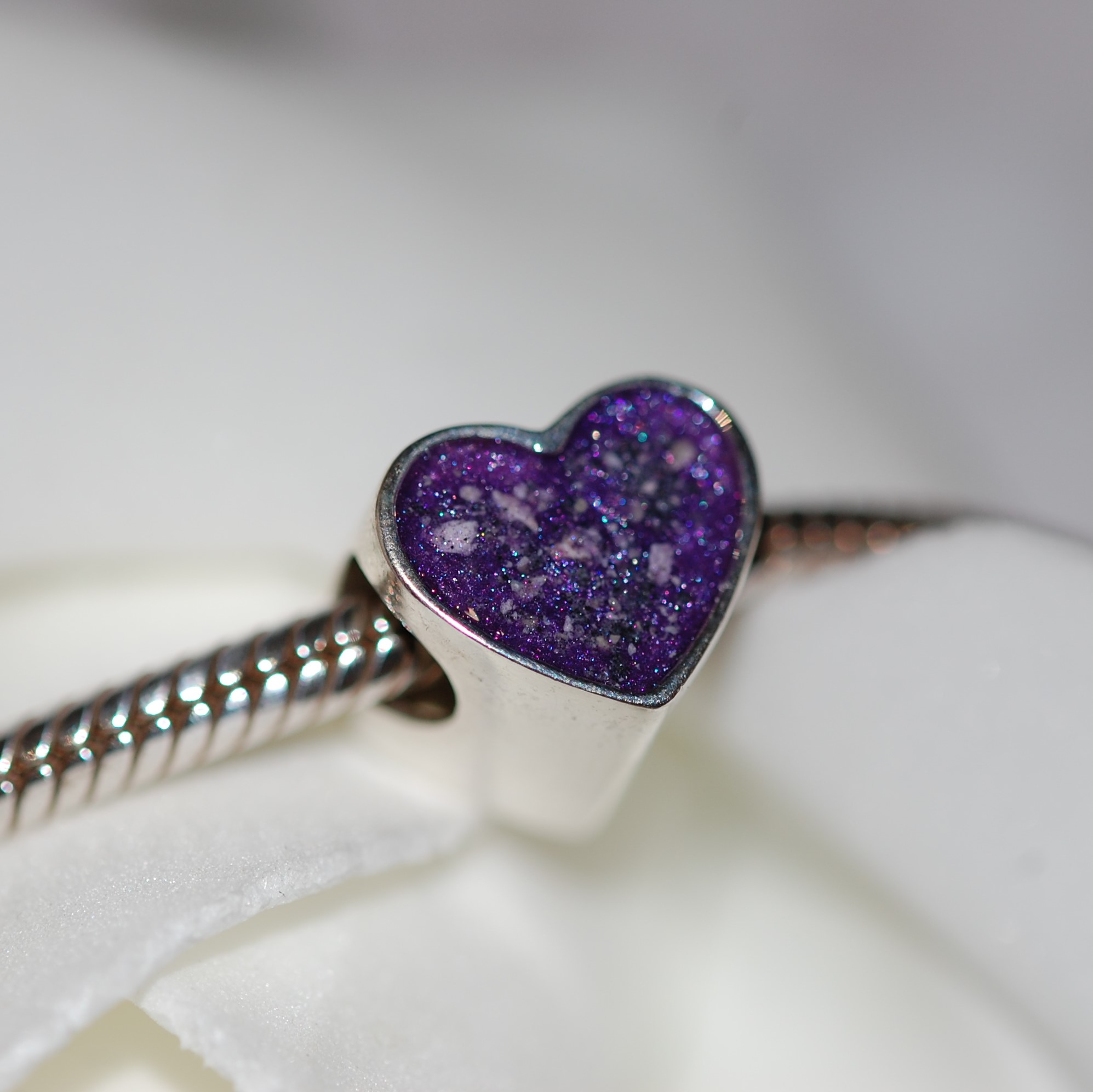 Pet memorial charm bead with your pet's fur or cremation ashes in resin