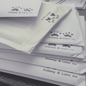 Envelopes stamped with unique cat paw prints