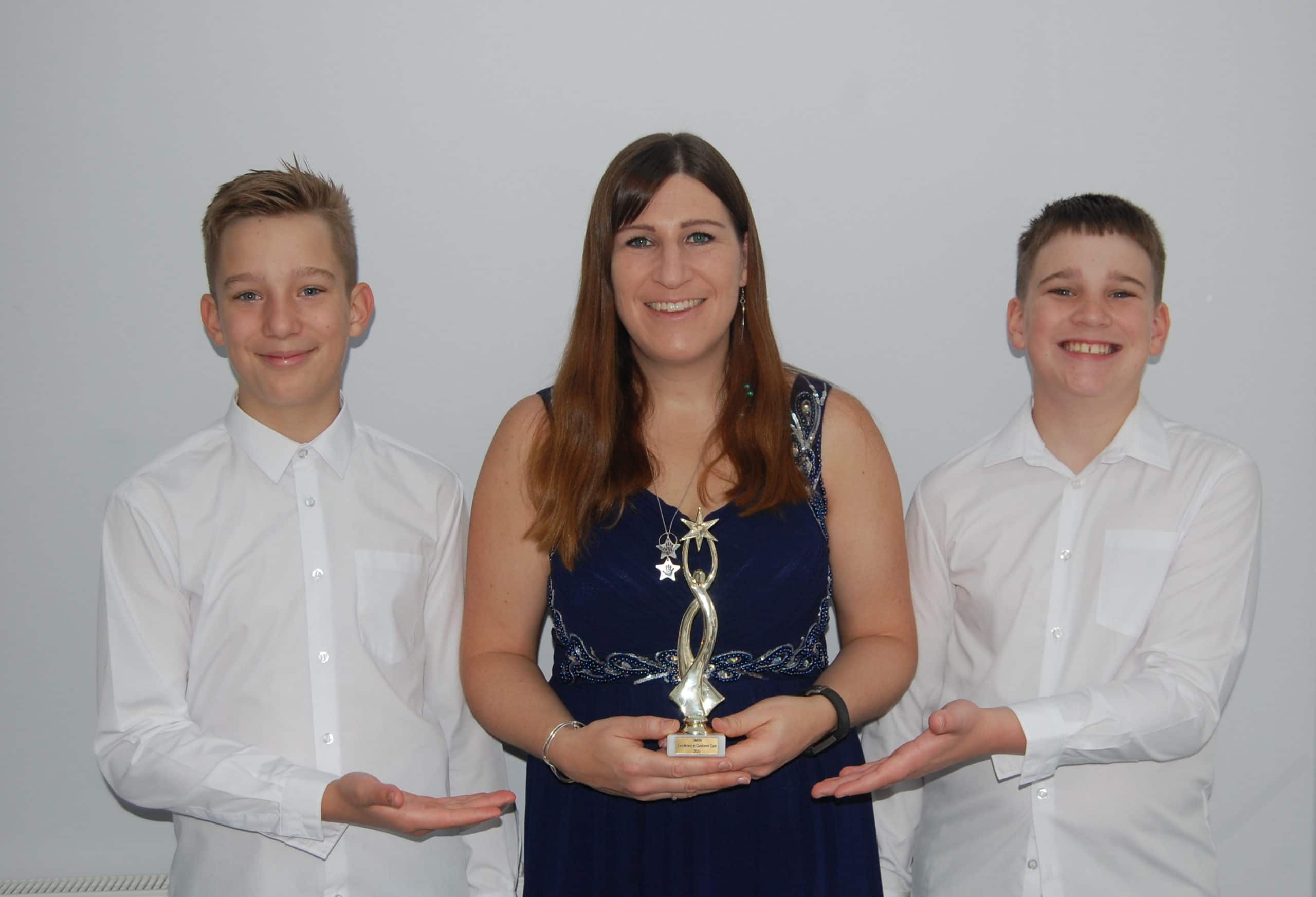 Lisa, Ollie and Jake with Award