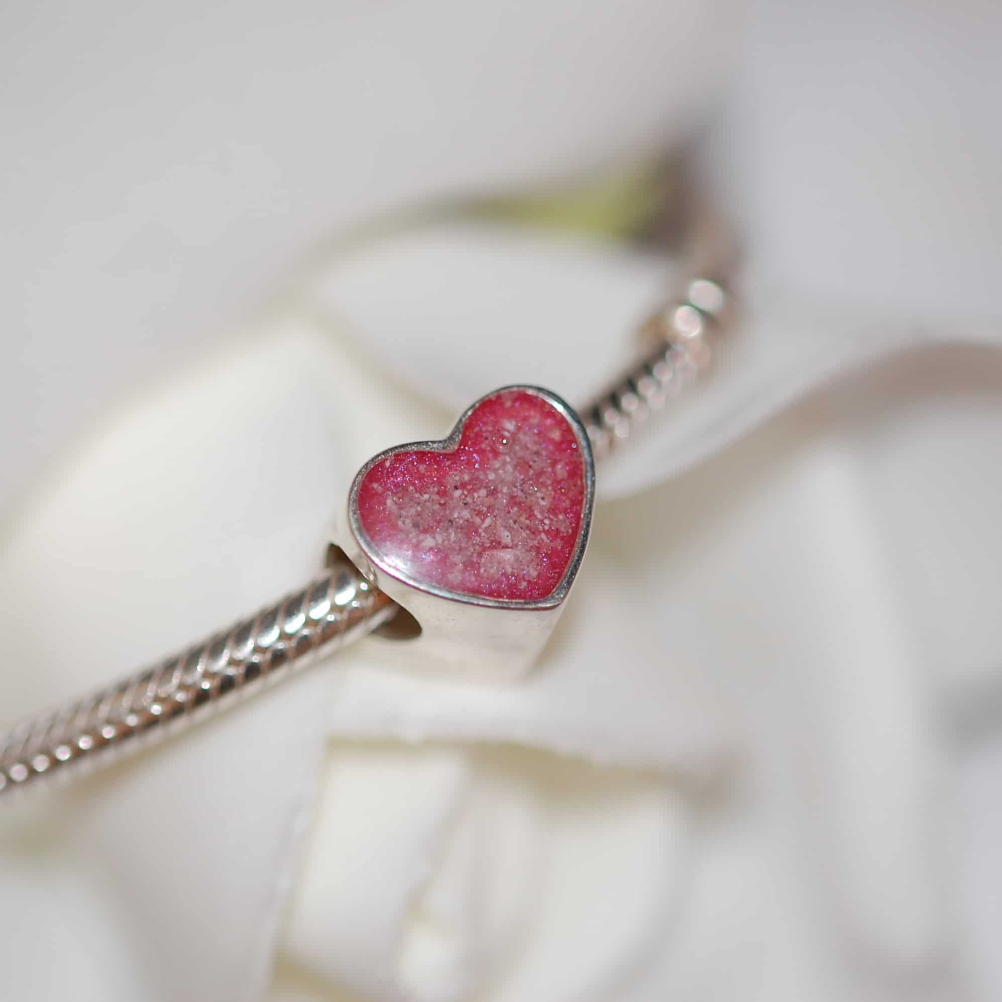 Silver heart charm bead with your pet's cremation ashes. Keepsakes are very important when thinking about dying matters and your wishes