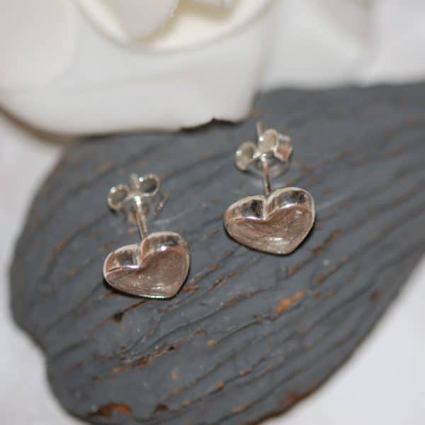 Silver heart stud earrings with pet fur or cremation ashes