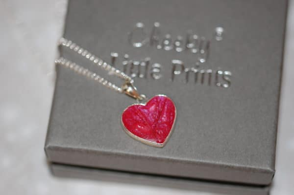 silver heart pendant with pet fur or cremation ashes