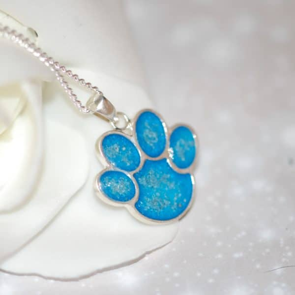 Silver paw print pendant with pet fur or cremation ashes