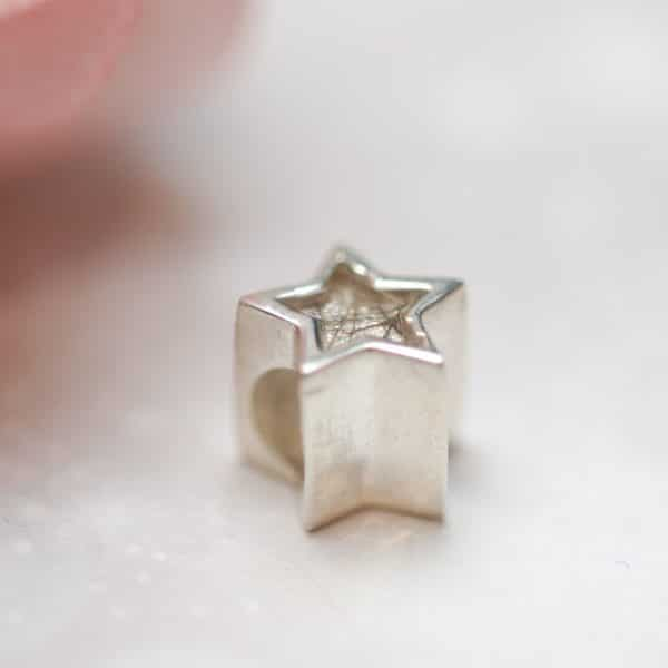 Star charm bead with pet fur or cremation ashes side view