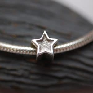 Silver star charm bead with pet fur or cremation ashes