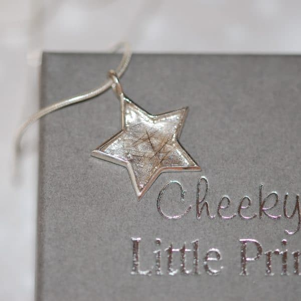 Silver star pendant with pet fur or cremation ashes