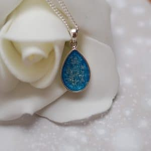 Silver tear drop pendant with pet fur or cremation ashes