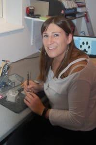 Lisa creating silver paw print jewellery