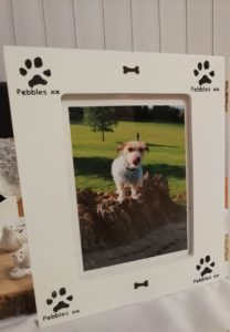 Photo frame decorated with personalised dog paw print stamp