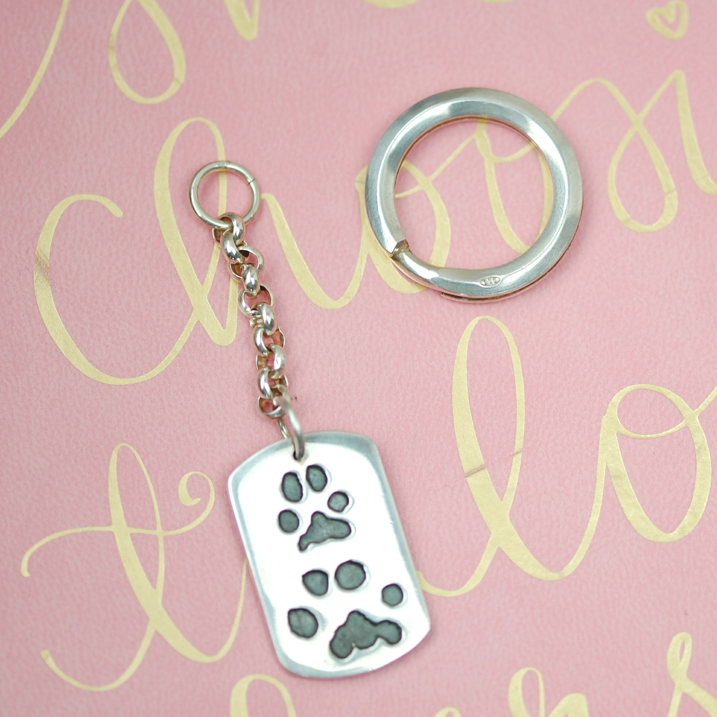 Large sterling silver dog tag keyring with your pet's unique paw prints. Dog dad gifts.