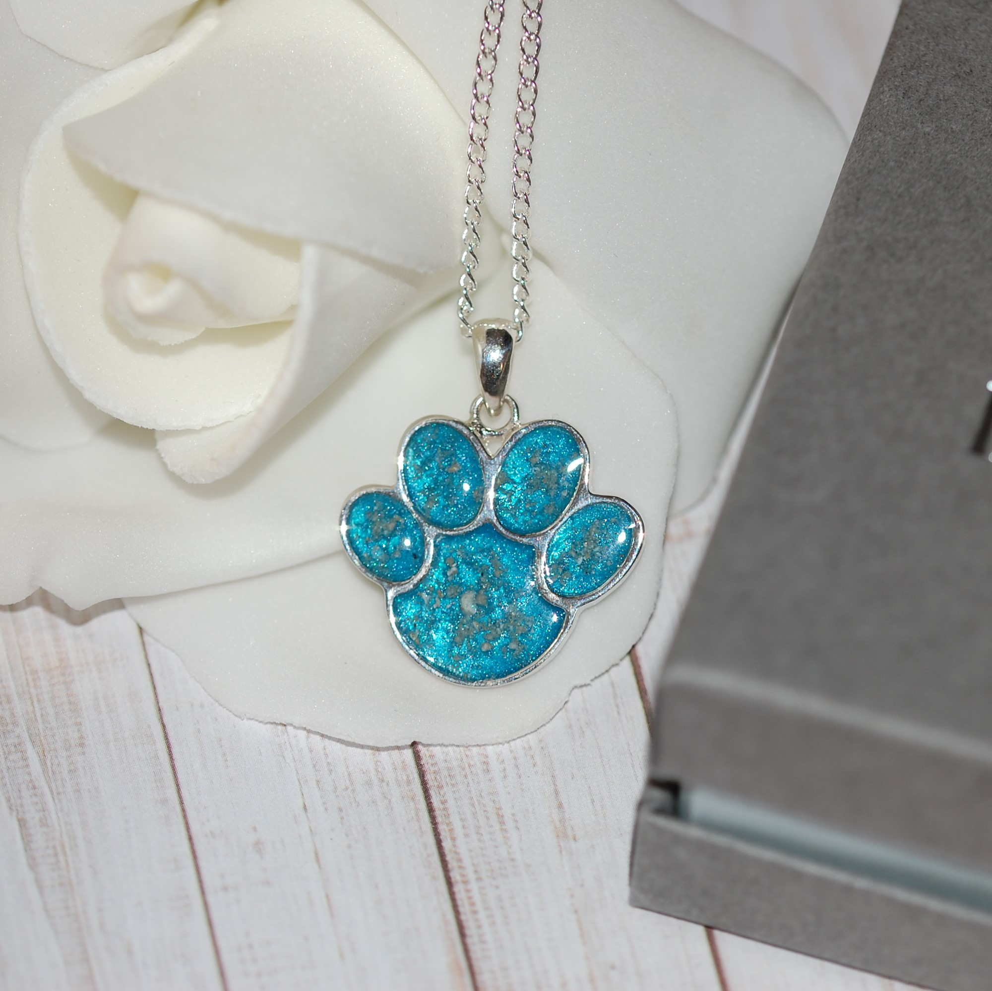 Dog memorial paw print pendant with cremation ashes