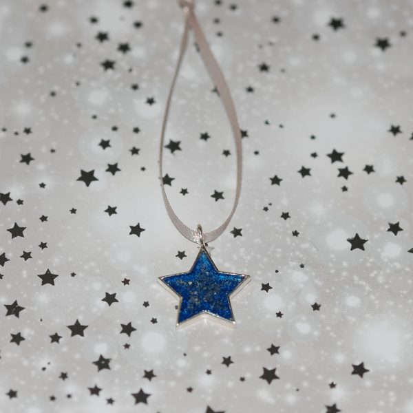 Silver star Christmas decoration with pet cremation ashes and blue resin