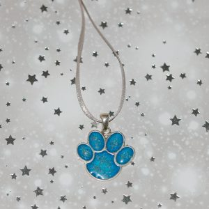 Silver paw print Christmas decoration with ashes