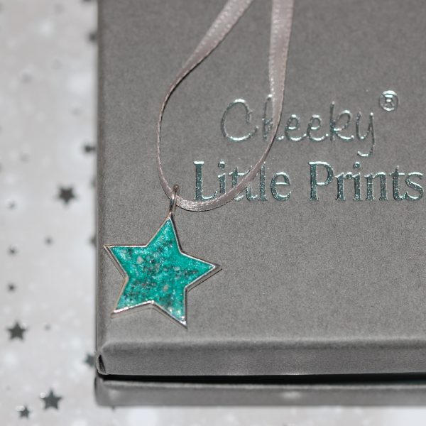 Silver star Christmas decoration with pet cremation ashes and teal resin